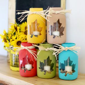 Bright colorful jars with maple leaf patern for candles