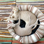 Siamese-cats-in-cat-bed