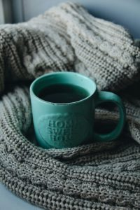 Cup of coffee on a blanket