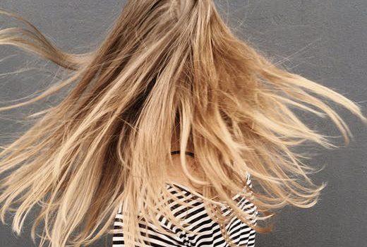 Blond woman waving her long hair