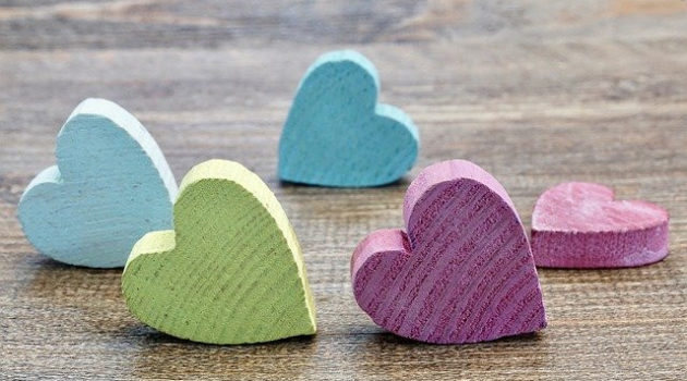 Wooden colored hearts in lime, pink and turqoise