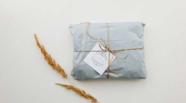 Present wrapped in ice blue paper with ecru string