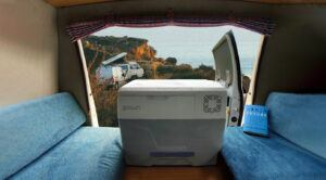 View from within a camping van over the GoSun Chill portable cooler and the coast line